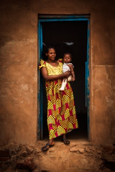 COOPI Midwife with her baby in a health center